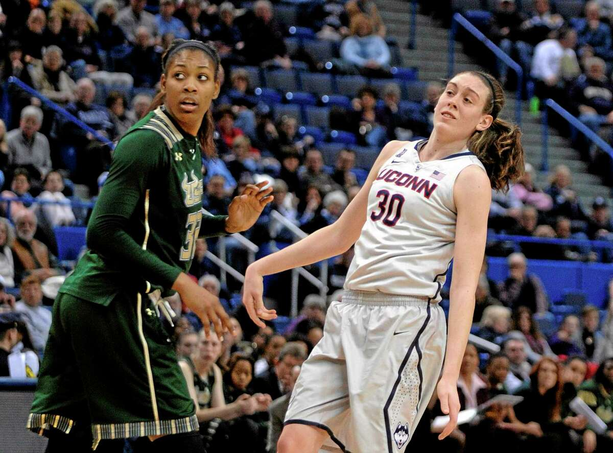Connecticut's Breanna Stewart (30) and South Florida's Akila McDonald (32) watch a Stewart three-point attempt during the second half of Connecticut's 81-53 victory in an NCAA college basketball game in Hartford, Conn., Sunday, Jan. 26, 2014. The shot would have broken Stewarts game-high point record of 29. (AP Photo/Fred Beckham)
