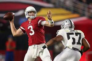 GLENDALE, AZ - AUGUST 12:  Quarterback Carson Palmer #3 of the Arizona Cardinals throws a pass over middle linebacker Cory James #57 of the Oakland Raiders during the first half of the NFL game at the University of Phoenix Stadium on August 12, 2017 in Glendale, Arizona.  (Photo by Christian Petersen/Getty Images)