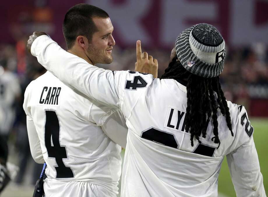 Oakland Raiders quarterback Derek Carr (4) and Marshawn Lynch talks on the sideline during the first half of an NFL preseason football game against the Arizona Cardinals, Saturday, Aug. 12, 2017, in Glendale, Ariz. (AP Photo/Rick Scuteri) Photo: Rick Scuteri, Associated Press