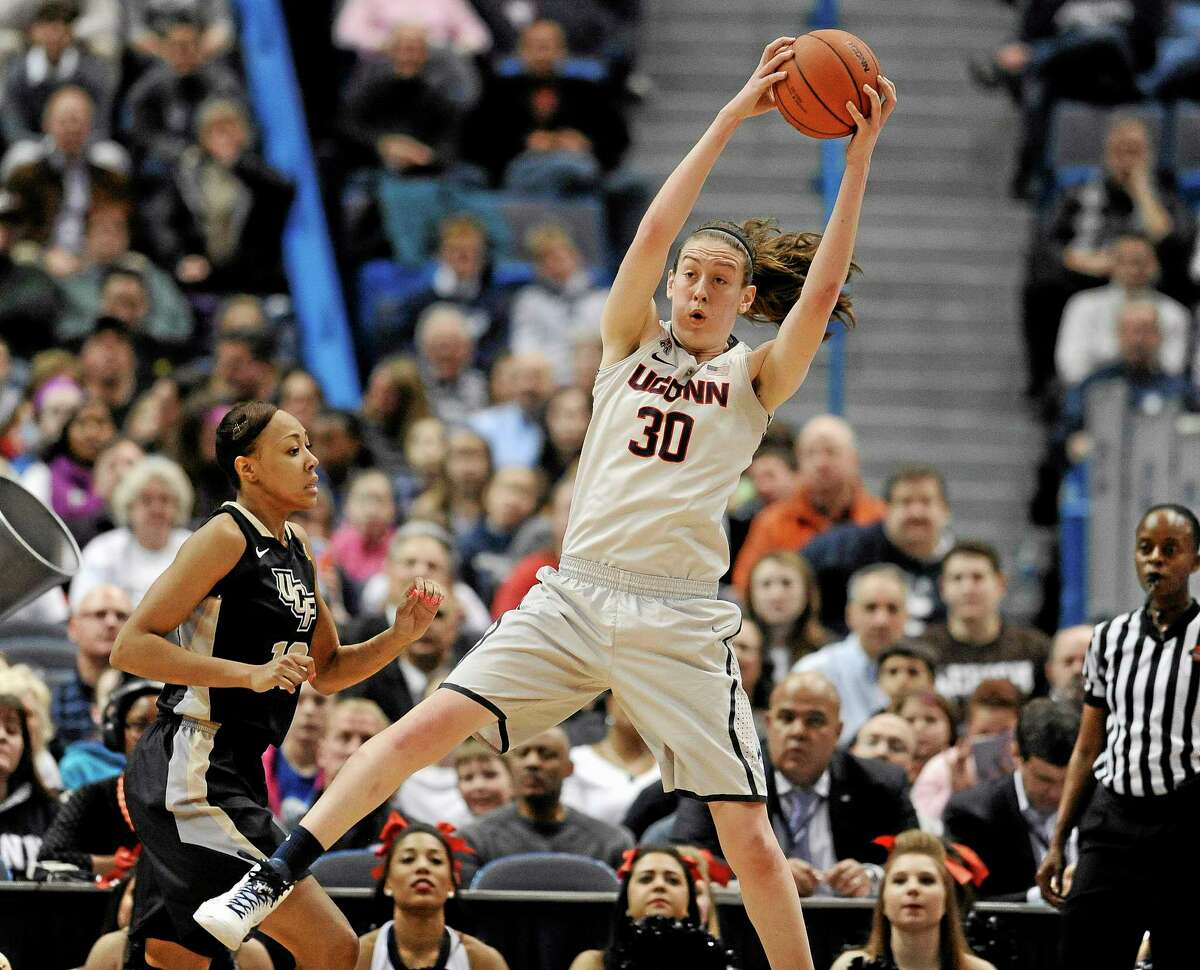 UConn's Breanna Stewart reaches up for a defensive rebound as Central Florida's Brittni Montgomery, left, defends during Wednesday's game.