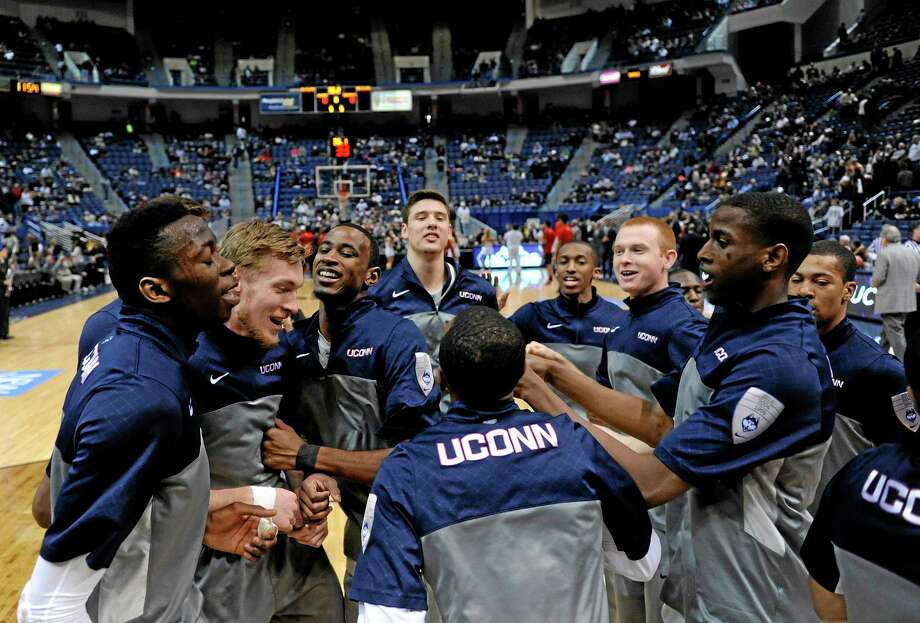 UConn shares a light moment before its 51-45 win over No. 11 Cincinnati at the XL Center in Hartford on Saturday. Photo: Fred Beckham — The Associated Press  / FR153656 AP