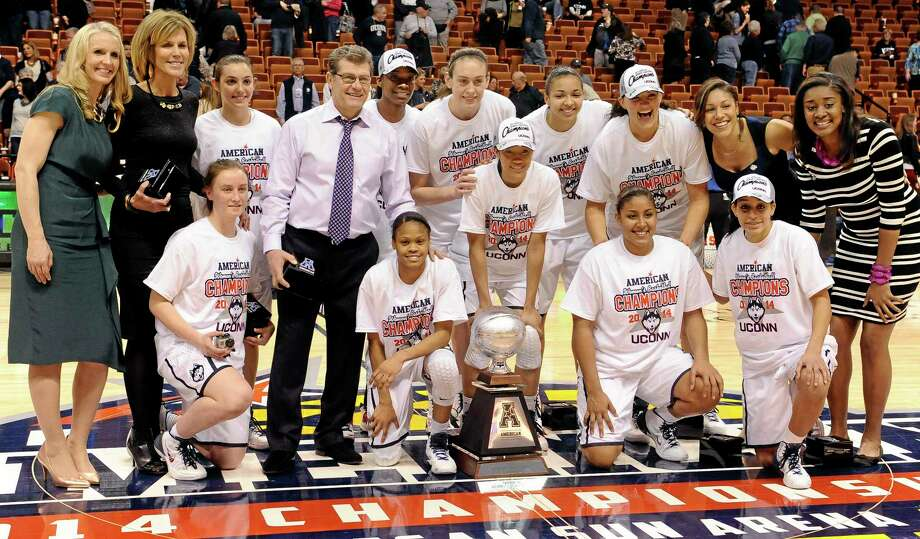The UConn women's basketball team poses for a photograph with their trophy after winning the inaugural American Athletic Conference tournament against Louisville on Monday. Photo: Jessica Hill — The Associated Press  / FR125654 AP