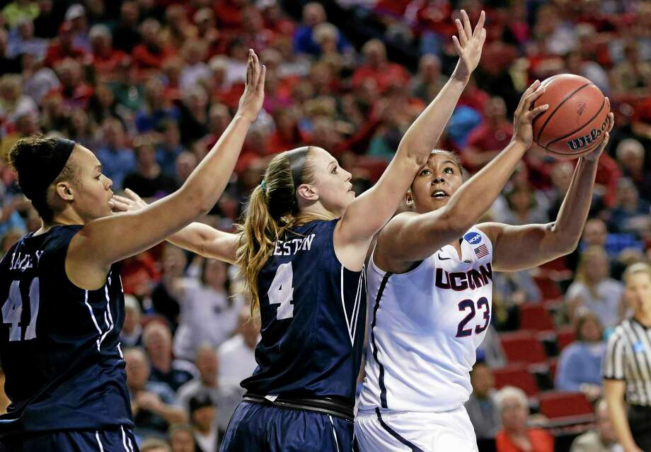 UConn's Kaleena Mosqueda-Lewis (23) is defended by BYU's Kim Beeston (4) and Morgan Bailey (41) during the first half Saturday. Photo: Nati Harnik — The Associated Press  / AP