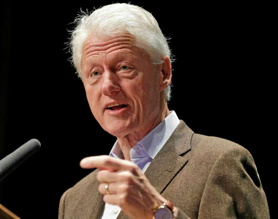 FILE - In this Oct. 30, 2013 file photo, former President Bill Clinton speaks in Charlottesville, Va. Photo: (AP Photo/Steve Helber, File) / AP