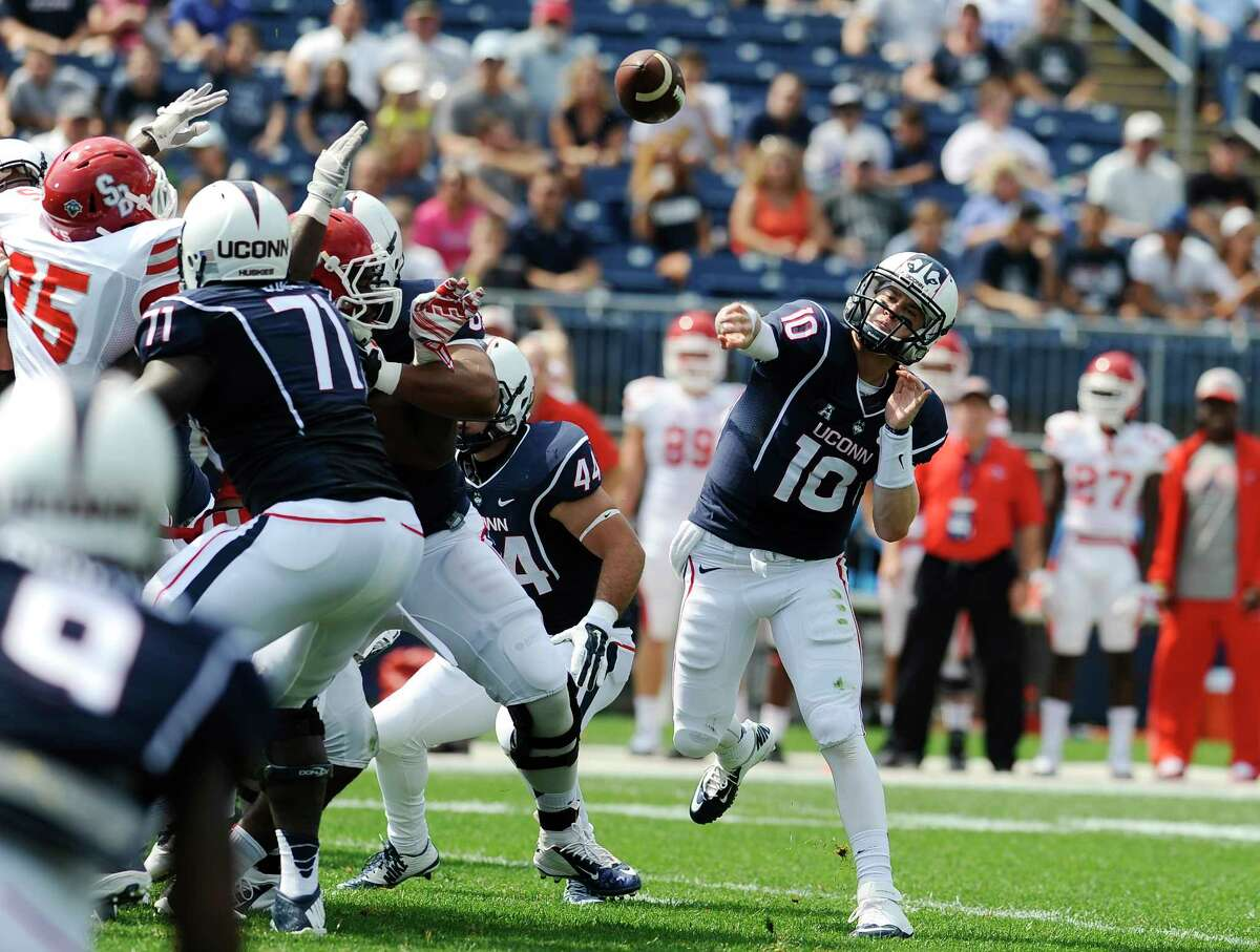 Connecticut quarterback Chandler Whitmer (10) throws during the first half of an NCAA college football game against Stony Brook at Rentschler Field, Saturday, Sept. 6, 2014, in East Hartford, Conn. (AP Photo/Jessica Hill)
