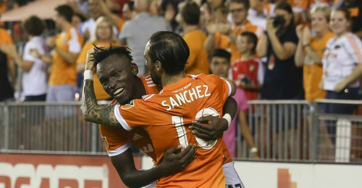 Houston Dynamo players Alberth Elis (17) and Vicente Sanchez (10) celebrate Sanchez's first goal of the game during the second half of the game at BBVA Compass Stadium Saturday, Aug. 12, 2017, in Houston. Houston Dynamo defeated San Jose Earthquakes 3-0.( Yi-Chin Lee / Houston Chronicle )