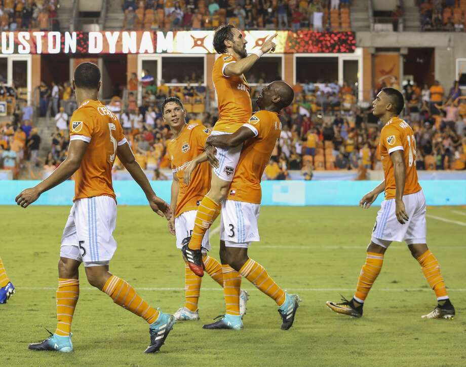 Houston Dynamo defender Adolfo Machado (3) carries forward Vicente Sanchez (10) to celebrate Sanchez's first goal of the night during the second half of the game at BBVA Compass Stadium Saturday, Aug. 12, 2017, in Houston. Houston Dynamo defeated San Jose Earthquakes 3-0.( Yi-Chin Lee / Houston Chronicle ) Photo: Yi-Chin Lee/Houston Chronicle