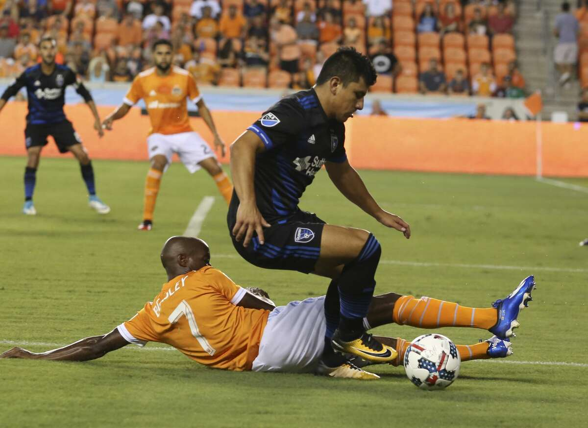 Houston Dynamo defender DaMarcus Beasley (7) tackles San Jose Earthquakes defender Nick Lima (24) while defensing during the first half of the game at BBVA Compass Stadium Saturday, Aug. 12, 2017, in Houston. ( Yi-Chin Lee / Houston Chronicle )