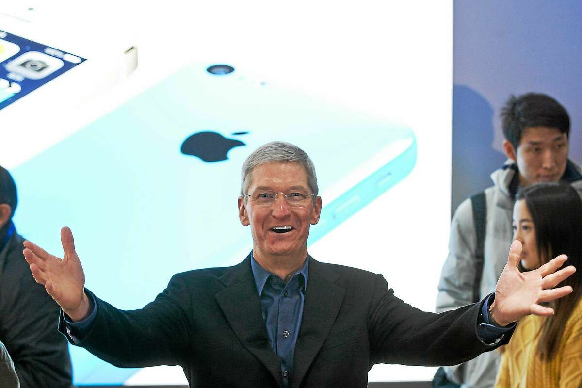 (AP Photo/Alexander F. Yuan) Apple's CEO Tim Cook gestures during a promotional event on Jan. 17, 2014.