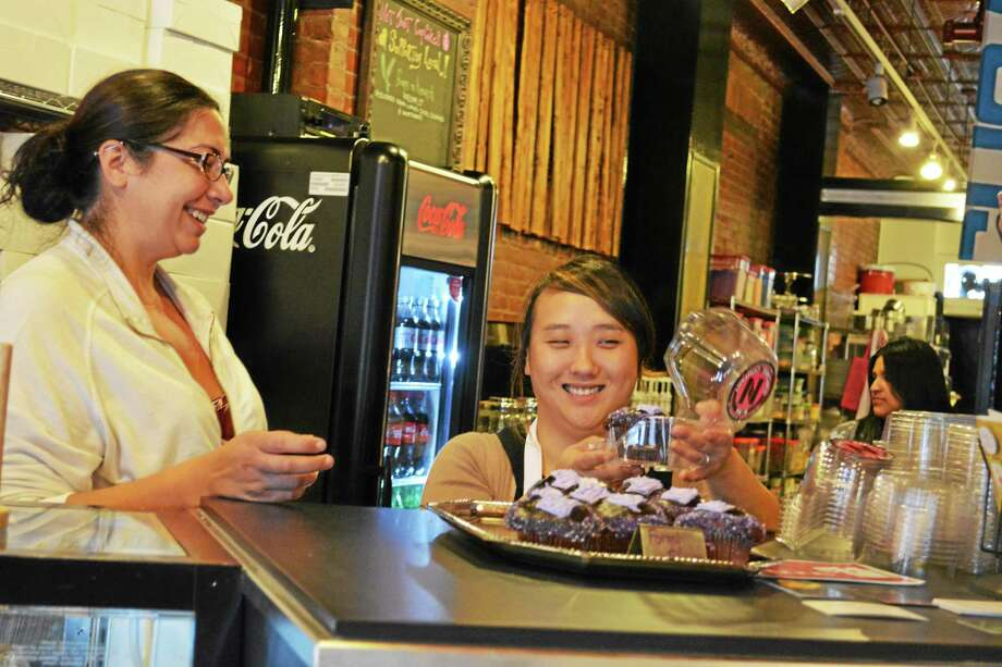 "<a href=""http://www.middletownpress.com/general-news/20121115/nora-cupcake-company-get-main-street-business-award-from-middlesex-chamber-of-commerce-2"">NoRA Cupcake Co.</a> on Middletown's Main Street is offering its Forget Me Not cream-filled chocolate cupcake with chocolate ganache to benefit the Alzheimer's Association. Photo: Kathleen Schassler - The Middletown Press"