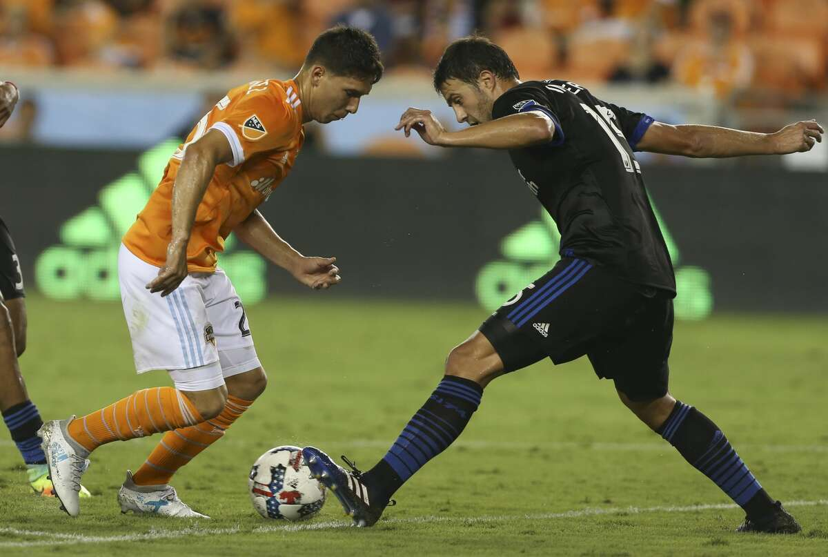 San Jose Earthquakes defender Andres Imperiale (15) gets the ball away from Houston Dynamo midfielder Tomas Martinez (25) during the second half of the game at BBVA Compass Stadium Saturday, Aug. 12, 2017, in Houston. Houston Dynamo defeated San Jose Earthquakes 3-0.( Yi-Chin Lee / Houston Chronicle )