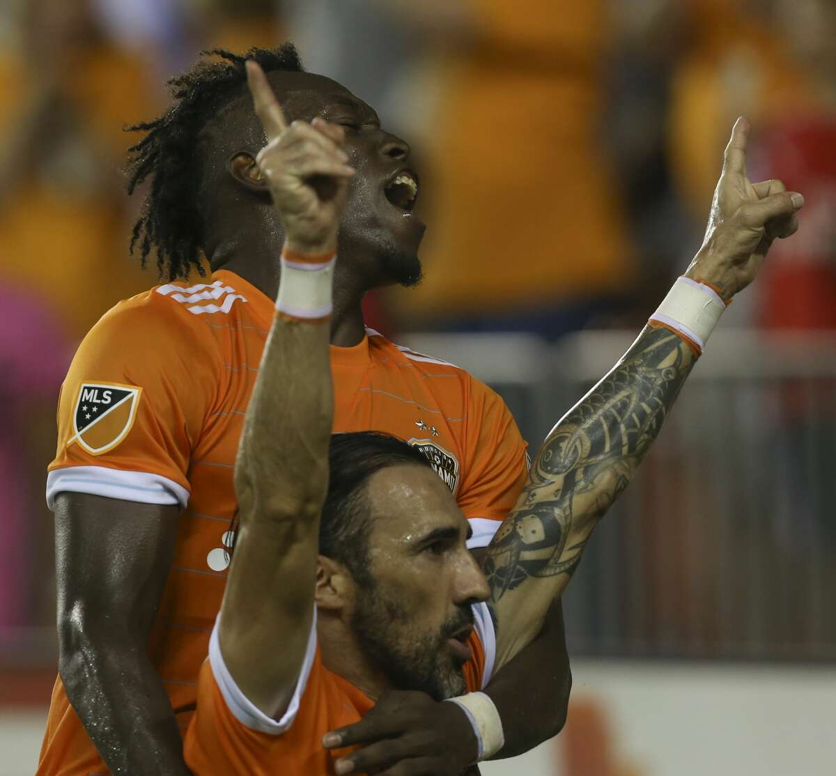 Houston Dynamo forward Alberth Elis (17) and forward Vicente Sanchez (10) celebrating Sanchez's first goal during the second half of the game at BBVA Compass Stadium Saturday, Aug. 12, 2017, in Houston. Houston Dynamo defeated San Jose Earthquakes 3-0.( Yi-Chin Lee / Houston Chronicle )