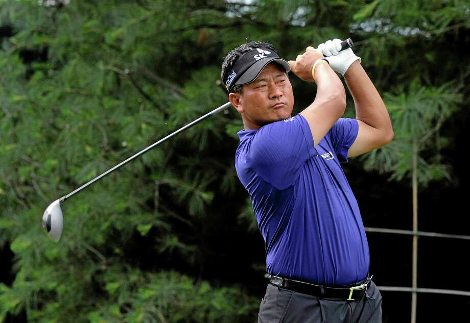 K.J. Choi watches his drive on the 10th hole during the first round of the Travelers Championship on Thursday in Cromwell. Photo: Fred Beckham — The Associated Press  / FR153656 AP