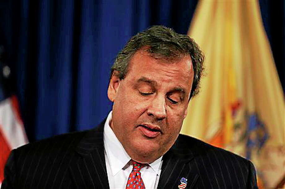 New Jersey Gov. Chris Christie speaks during a news conference Thursday, Jan. 9, 2014 at the Statehouse in Trenton. N.J. Christie has fired a top aide who engineered political payback against a town mayor, saying she lied. Deputy Chief of Staff Bridget Anne Kelly is the latest casualty in a widening scandal that threatens to upend Christie's second term and likely run for president in 2016. Documents show she arranged traffic jams to punish the mayor, who didn't endorse Christie for re-election.  (AP Photo/Matt Rourke) Photo: AP / AP