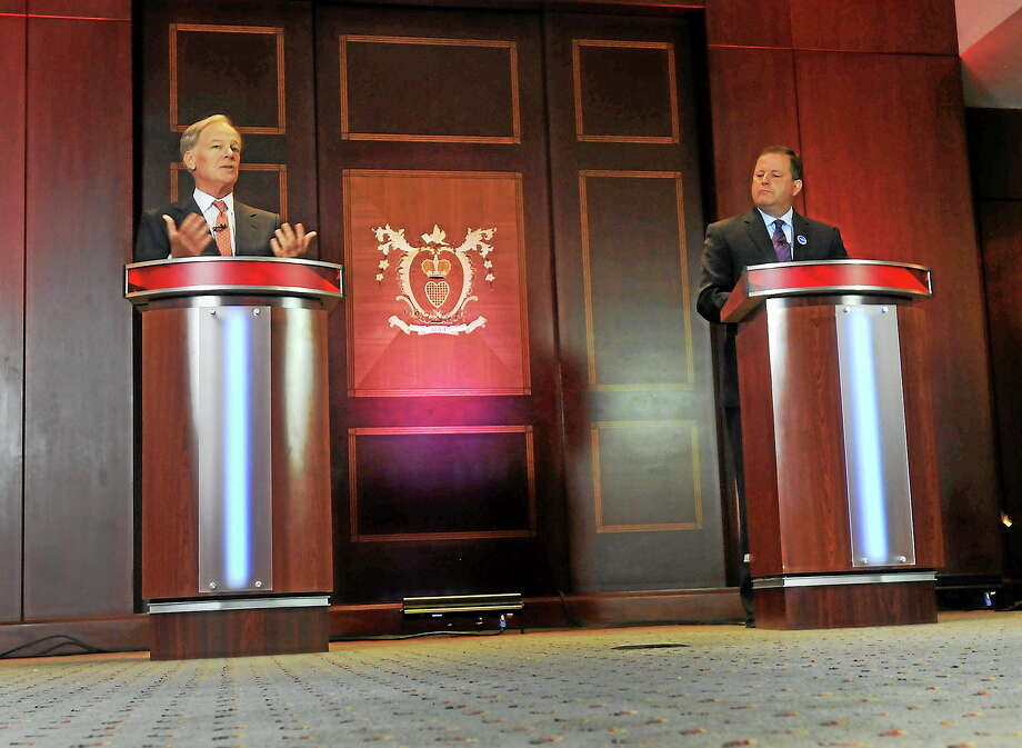 Republican candidates for governor Tom Foley, left, and John McKinney square off during a debate, held at the Hartford Courant building on July 17, 2014, for the two Republicans running for governor in Connecticut. Photo: AP Photo/Hartford Courant, Brad Horrigan, Pool  / Hartford Courant Pool