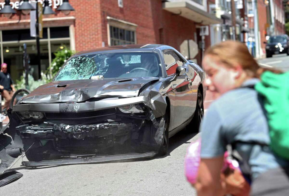 A vehicle reverses after driving into a group of protesters demonstrating against a white nationalist rally in Charlottesville, Va., Saturday, Aug. 12, 2017. The nationalists were holding the rally to protest plans by the city of Charlottesville to remove a statue of Confederate Gen. Robert E. Lee. There were several hundred protesters marching in a long line when the car drove into a group of them. (Ryan M. Kelly/The Daily Progress via AP) ORG XMIT: VACHA102