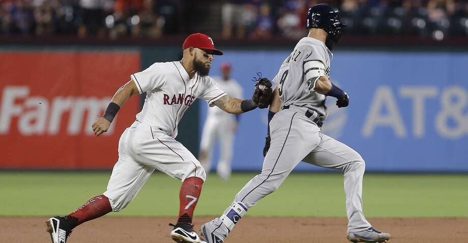 Texas Rangers second baseman Rougned Odor, left, tags out Houston Astros' Marwin Gonzalez (9) during the second inning of a baseball game Saturday, Aug. 12, 2017, in Arlington, Texas. Marwin attempted to stretch a single into a double on the play. (AP Photo/Brandon Wade) Photo: Brandon Wade/Associated Press