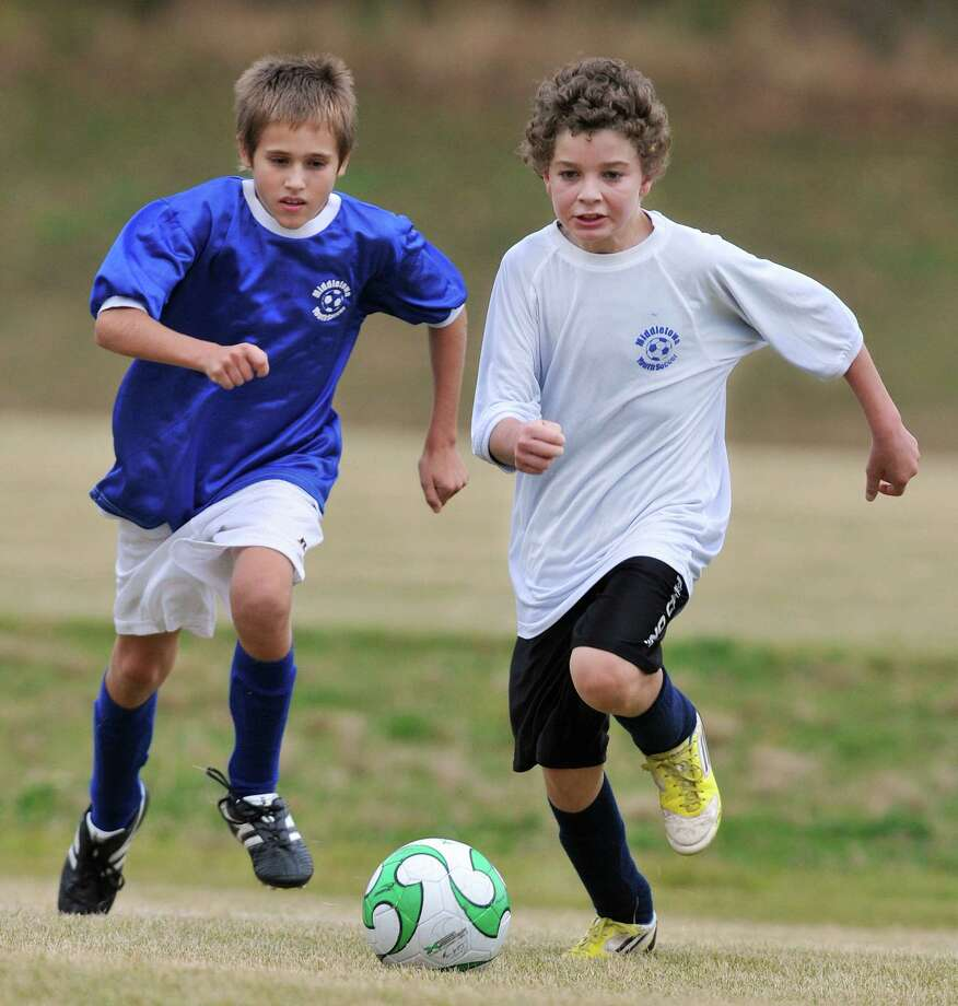 Soccer Recreational League players race to the ball at Moody School Field on Country Club Road in Middletown in this file photo. Photo: Catherine Avalone - The Middletown Press  / TheMiddletownPress