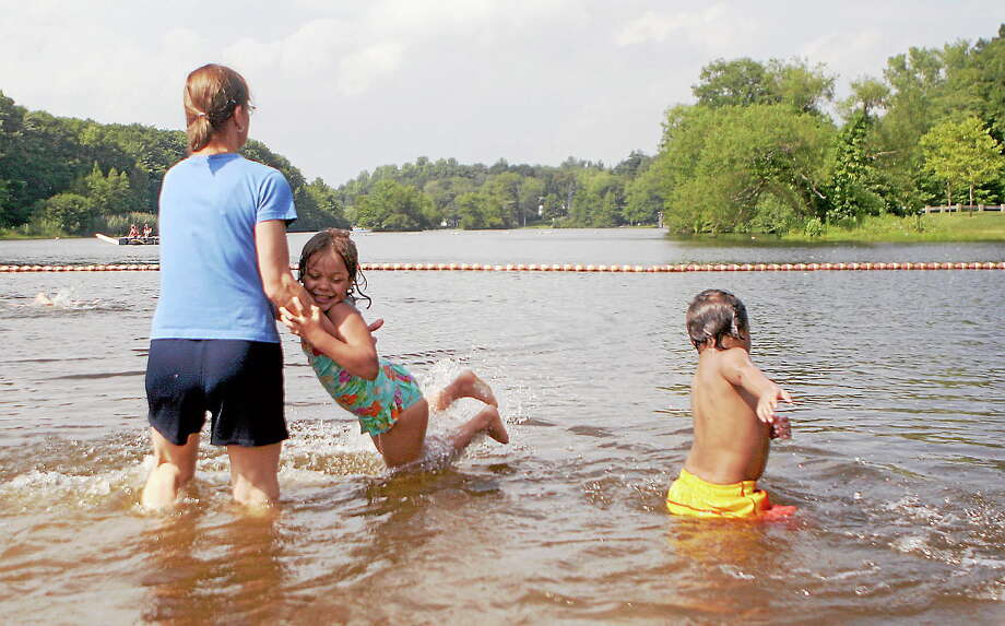 File photo Five-year-old Marlee Gatling, of Waterbury, is spun around in the water by her grandmother, Middletown resident Maureen Carpenter, and he 3-year-old brother, M.J., right, splashes next to them at Crystal Lake in Middletown. Photo: Journal Register Co.