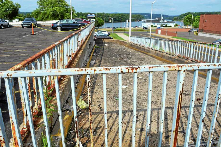 Middletown's aging Arcade parking lot is in a state of disrepair. Photo: Cassandra Day - The Middletown Press