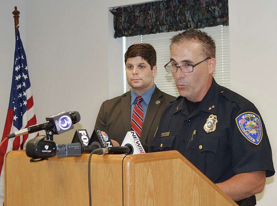Cassandra Day ó The Middletown Press  Middletown Mayor Dan Drew announces at a press conference July 2 that an independent investigation has cleared Police Chief William McKenna of charges he solicited prescription narcotics from other officers. Photo: Journal Register Co.