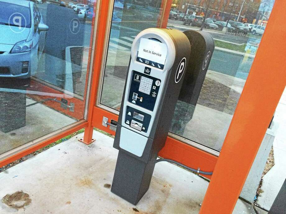 Beginning Jan. 5, motorists will enter their license plate numbers to pay for parking at the Arcade and Melilli Plaza parking lots. Photo: Alex Gecan — The Middletown Press