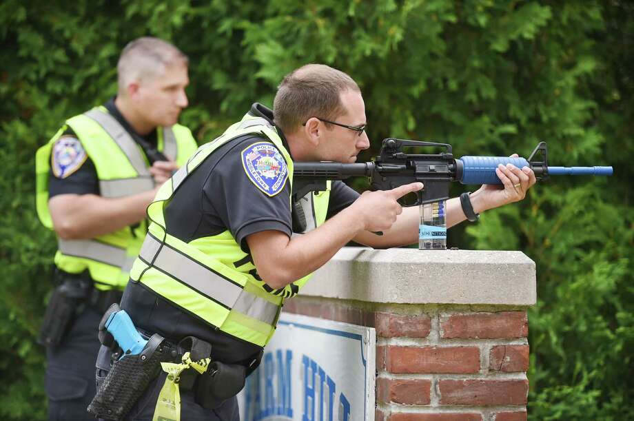 Members of the Middletown Police Department at Farm Hill Elementary School on Ridge Road where hundreds participated in a mock drill involving two gunmen earlier this year. Photo: File Photo / The Middletown Press