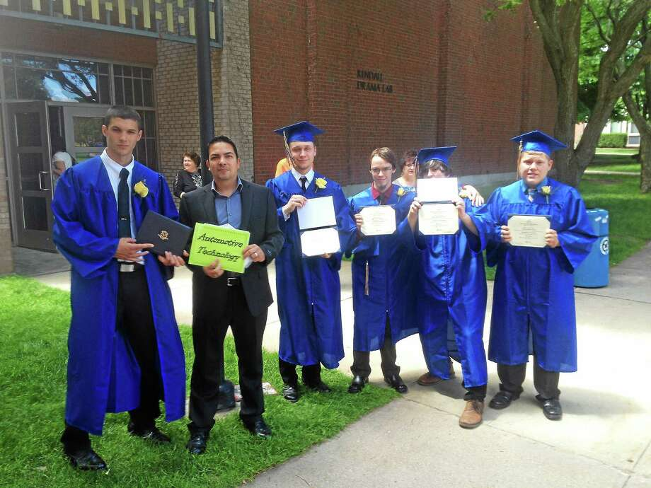 Alex Gecan - The Middletown Press Dean Pizzo, Josh Kelley, Brandon Kwolek, Zachary Craig and Jake Paranzino pose with automotive department head Carlos Nieves at the Vinal Technical High School Graduation at Southern Connecticut State University Saturday. Photo: Journal Register Co.
