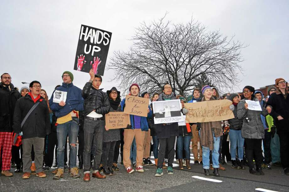 Wesleyan University students, supporters and faculty held a die-in protest and march to the intersection of Washington and Main streets in Middletown on Dec. 8. Photo: Cassandra Day — The Middletown Press