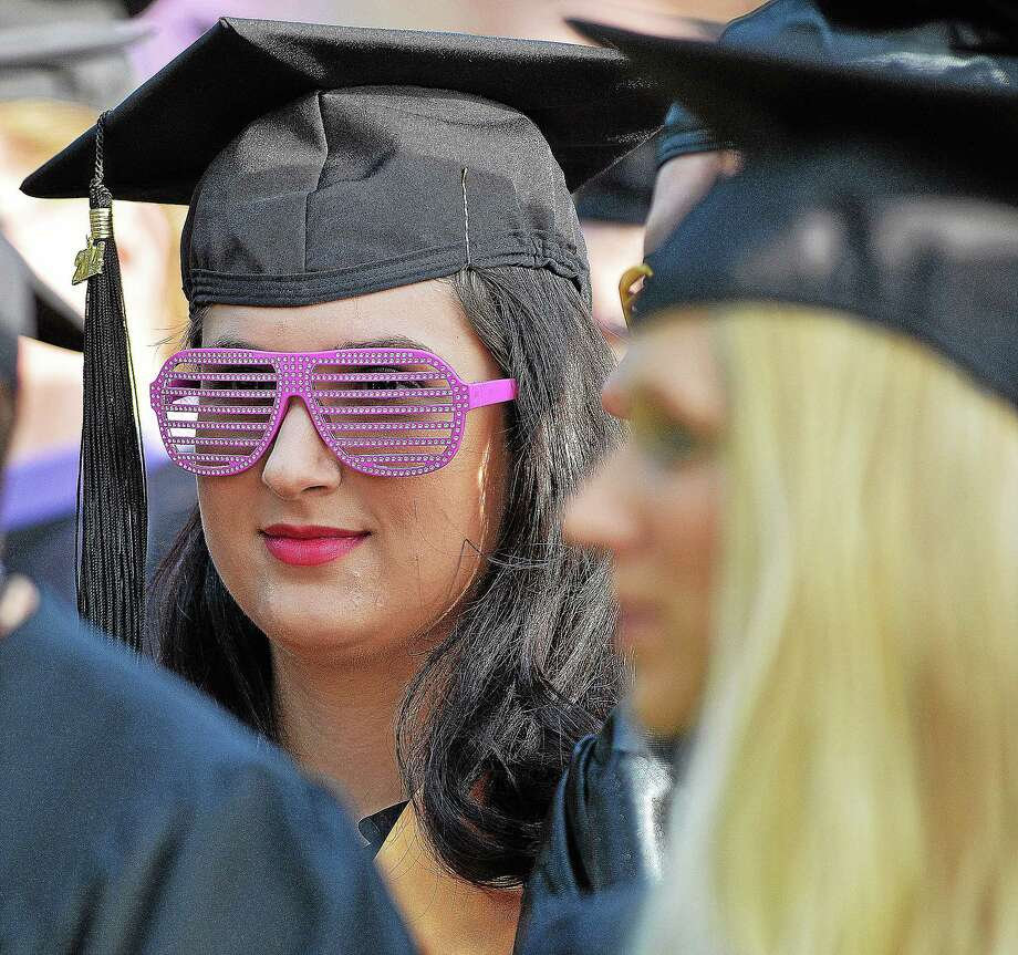 A member of Middlesex Community College listens to student representative Gina Layman give her speech to the class of 2014 Thursday evening. Photo: Catherine Avalone — The Middletown Press