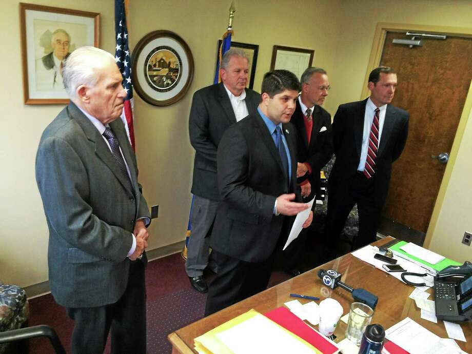 Mayor Daniel Drew (center) announced a plan for a six-story apartment tower adjacent to the MiddleOak building. From left, Middlesex County Chamber of Commerce President Larry McHugh, Comeau & Kelly builders President Dan Kelly, architect Jeffrey Bianco and MiddleOak Vice President Tom Ford joined the press conference. Photo: Alex Gecan — The Middletown Press