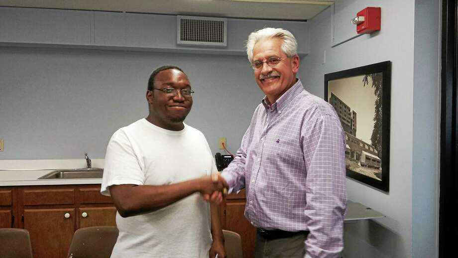 Clayton Smith, left, with Middletown Housing Authority Executive Director William Vasiliou. Smith and fellow Vinal Technical High School senior Alexandria Ellis will both receive the Angelo V. Aresco Scholarship, conferred by the MHA. Photo: Submitted Photo