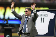 Edgar Martinez waves to the crowd following his speech during his number retiring ceremony at Safeco Field on Saturday, Aug. 12, 2017.