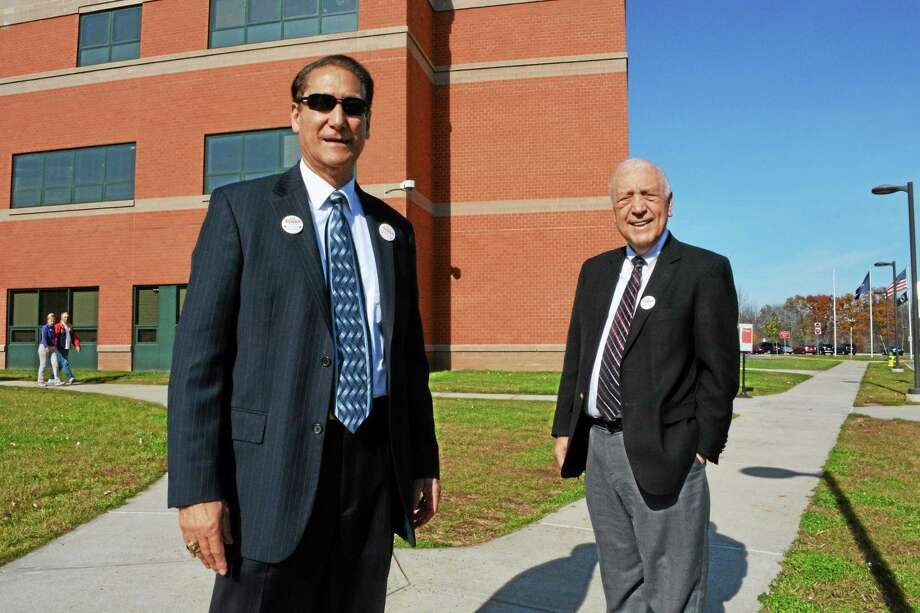 From left, Middletown Councilman Tom Serra and his brother, state Rep. Joseph Serra, D-33rd, talk to voters outside Middletown High School Tuesday. Joseph Serra's Republican opponent Linda Szynkowicz conceded the race at 9 p.m. Photo: Cassandra DAy — The Middletown Press