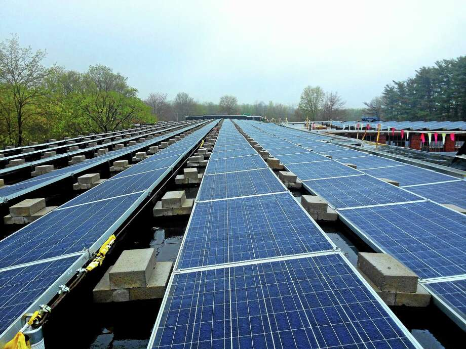 The GreenSkies solar array atop the Remington Rand building is nearing completion. The company is seeking agreements to build another two arrays at city properties. Photo: Alex Gecan — The Middletown Press