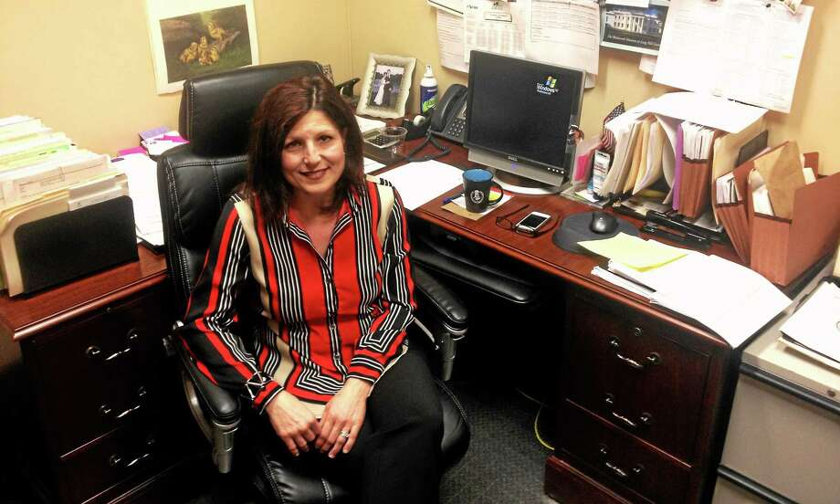 Alex Gecan - The Middletown Press Risk Manager Dawn Warner is retiring after a quarter century working at city hall. IT Director Bill Oliver resigned last week. Photo: Journal Register Co.