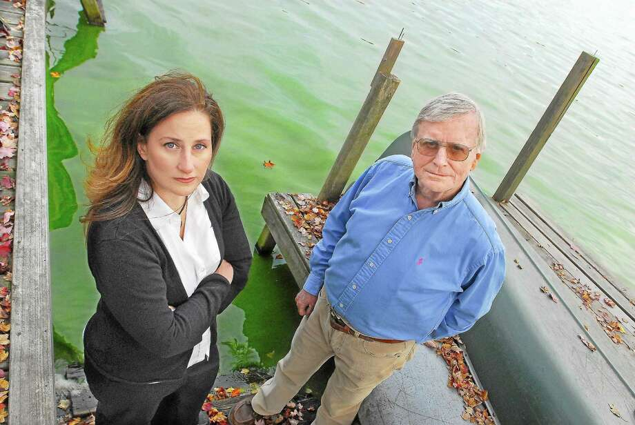 Middlefield residents Amy Poturnicki, president of the Lake Beseck Association, and Dick Boynton, vice president, are seen in this October 2012 file photo on Boynton's dock. Photo: CATHERINE AVALONE — THE MIDDLETOWN PRESS