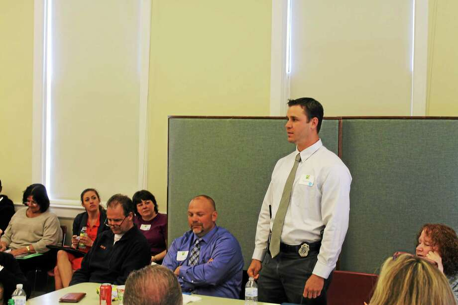 Jeff Pugliese - Middlesex County Chamber of Commerce Detective Frederick Dirga speaks to participants at the Middlesex County Substance Abuse Action Council's opiate forum Monday in Middletown. Photo: Journal Register Co.