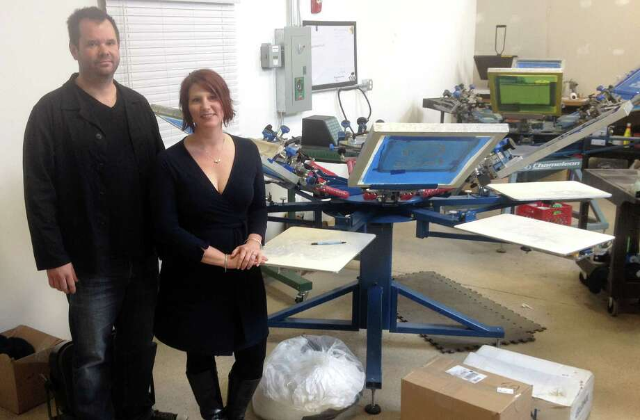 Alex Gecan - The Middletown Press Joel and Susan Volenec have been printing T-shirts since 2002 and recently opened up a workshop at the Remington Rand building. Photo: Journal Register Co.