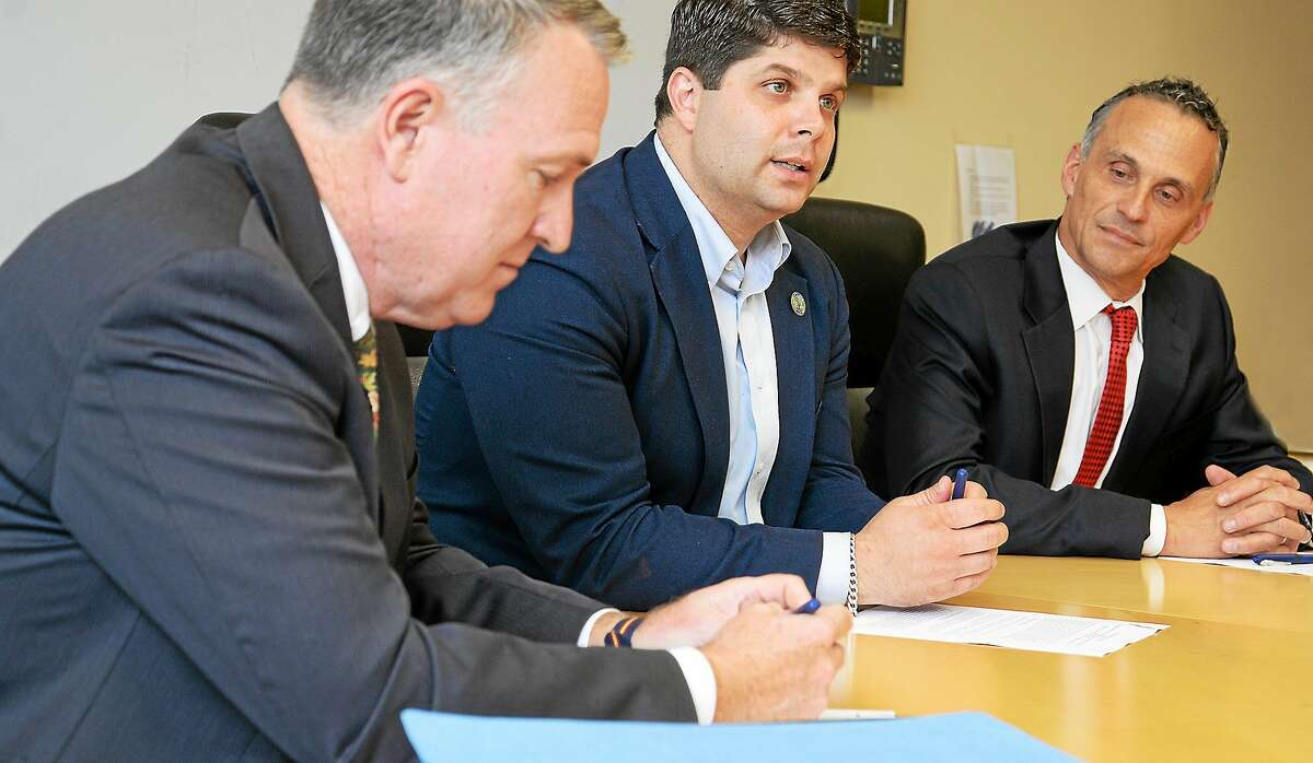 State's Attorney Peter McShane, Mayor Daniel Drew and Wesleyan University President Michael Roth signed a memorandum of understanding on Oct. 15 that laid out each party's role for future investigations of sexual assault on campus.