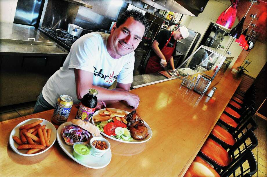 Duncan Olaechea, owner of Sabroso at 170 Main Street in Middletown with his mother, Maria Paquette, is taking his eatery to the streets by converting his business to a food truck. Photo: Catherine Avalone/The Middletown Press  / TheMiddletownPress