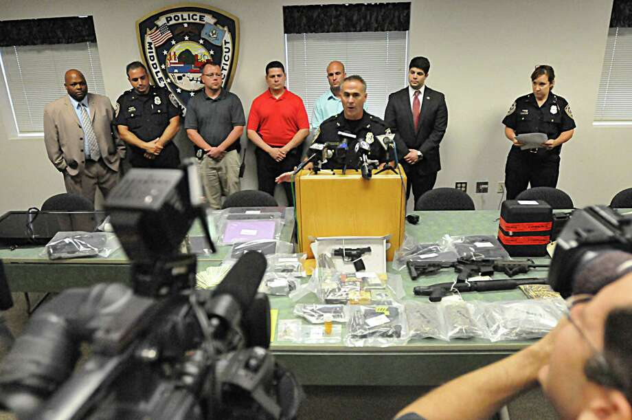 In this file photo, Chief William McKenna conducts a press conference at the Middletown Police Department Community Room after taking Vincent Sullivan, 24, into custody last year. Forty items were seized including $14,180 in cash, diamonds in a prescription bottle, weapons and drugs, police say. Photo: Catherine Avalone - The Middletown Press   / TheMiddletownPress