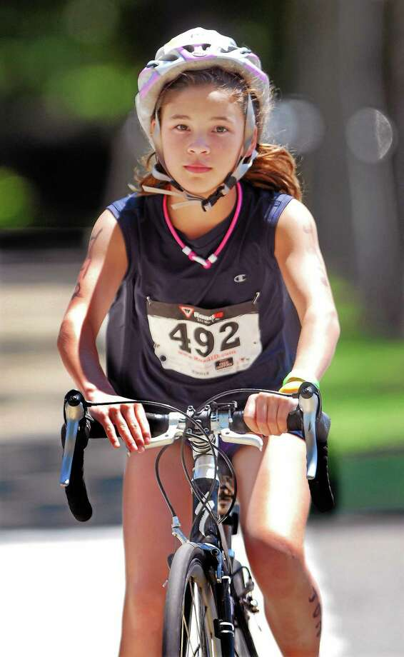 Middletown resident Abbey Clemmey rides a bike in this file photo. Photo: Middletown Press File Photo  / a