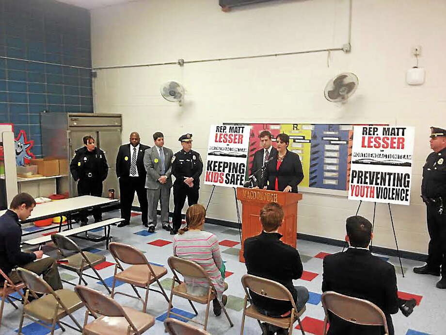 Alex Gecan - The Middletown Press Bobbye Knoll Peterson of the North End Action Team and Rep. Matt Lesser joined city officials and police Monday to talk about violence-reduction measures in Middletown, including a gun buy-back scheduled for this Saturday. Photo: Journal Register Co.