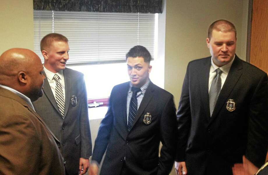 Alex Gecan / The Middletown Press Mayor Daniel Drew swore in Elliot Arroyo, Austin Smith and John Stroud and promoted Officer Douglas Clark to patrol sergeant Thursday afternoon. Photo: Journal Register Co.