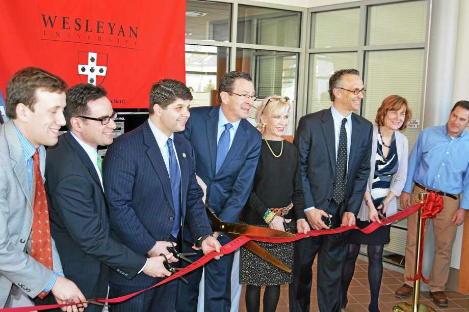 Gov. Dannel Malloy and Middletown Mayor Daniel Drew were among the people celebrating the opening of microgrid at Wesleyan in Middletown. Photo: Photos By Alex Gecan - The Middletown Press