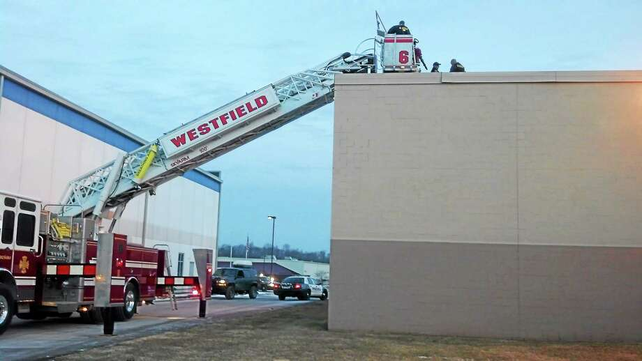 Middletown Police Department photo ¬ Westfield Fire provided a ladder truck to remove a burglary suspect safely from the roof of Electrical Wholesalers in Middletown. Photo: Journal Register Co.