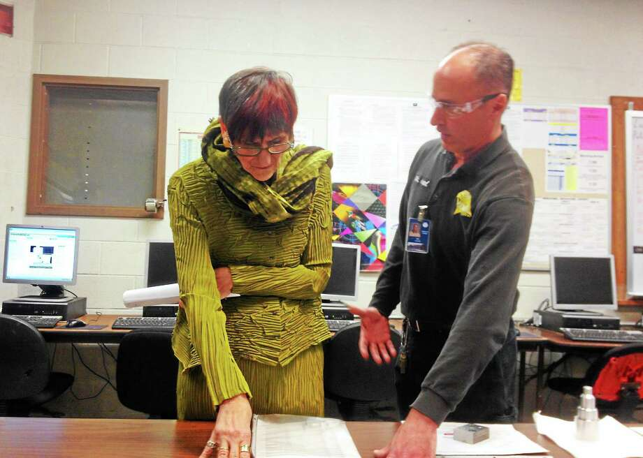 U.S. Rep. Rosa DeLauro learns about manufacturing education from Michael Hood, who runs the manufacturing technology department at Vinal Technical High School in Middletown, at a walk-through Thursday. Photo: Alex Gecan — The Middletown Press