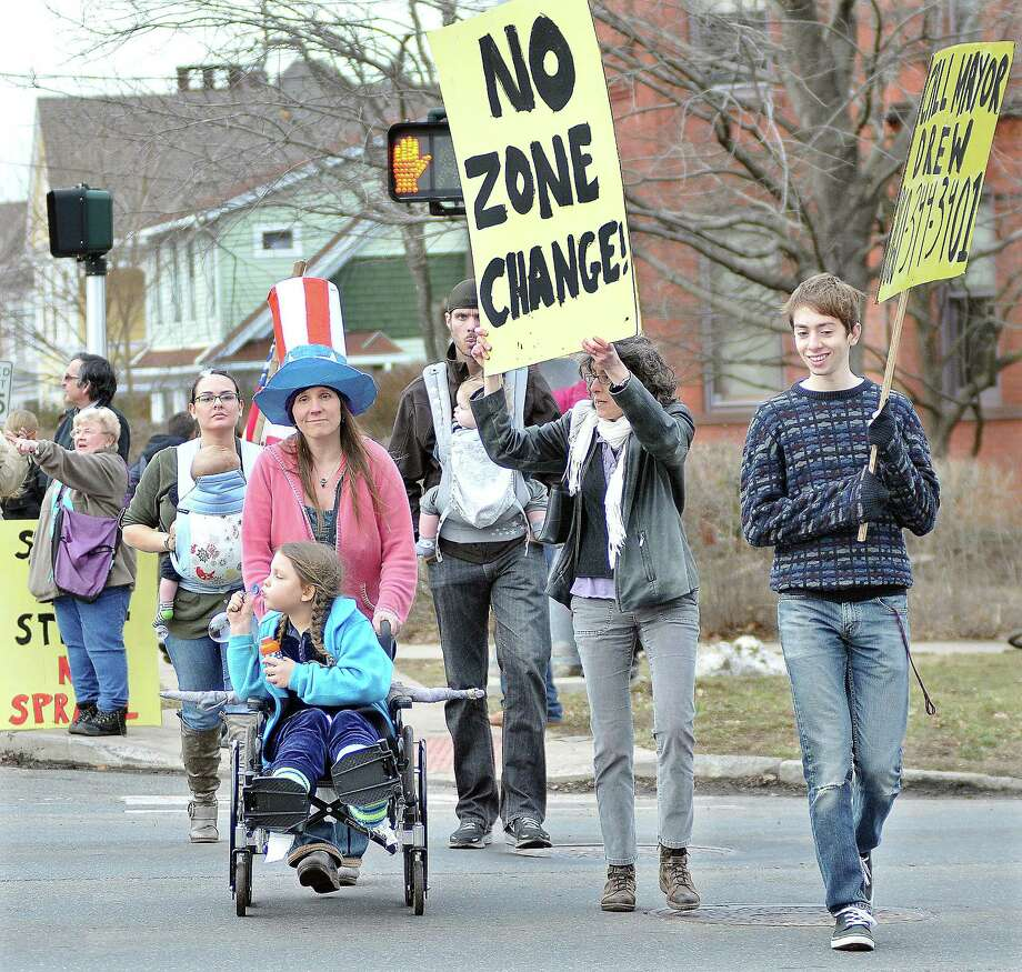 Catherine Avalone/The Middletown Press ¬ Approximately 40 Middletown residents protested carrying signs at the cross walk Monday at the intersection of Washington and High Streets in response to developer Robert Landinoís proposal to change zoning for a portion of Washington Street in Middletown. Photo: Journal Register Co. / TheMiddletownPress
