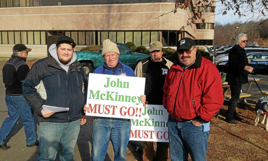 """Blogger Chris """"Palin Smith"""" Ford, center-left (in wool cap), rallies with CCDL members outside DESPP building on Dec. 31. Photo: Alex Gecan — The Middletown Press"""